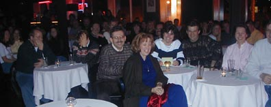 Folks Having Fun At A Comedy Show
